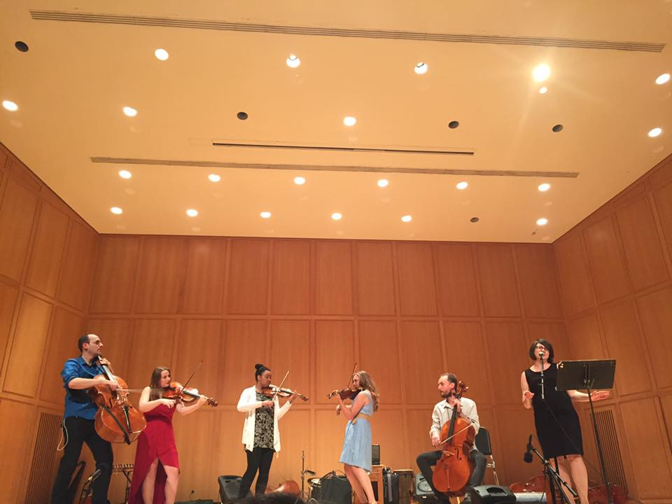 Jamie singing with a band at the Silk Road Ensemble Global Musician Workshop.